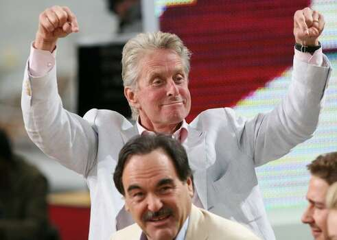 "US film maker Oliver Stone (down) and US actor Michael Douglas attend Canal Plus TV program ""Le Grand Journal"" on May 15, 2010 in Cannes, at the 63rd Cannes Film Festival. AFP PHOTO / LOIC VENANCE Photo: Getty Images"