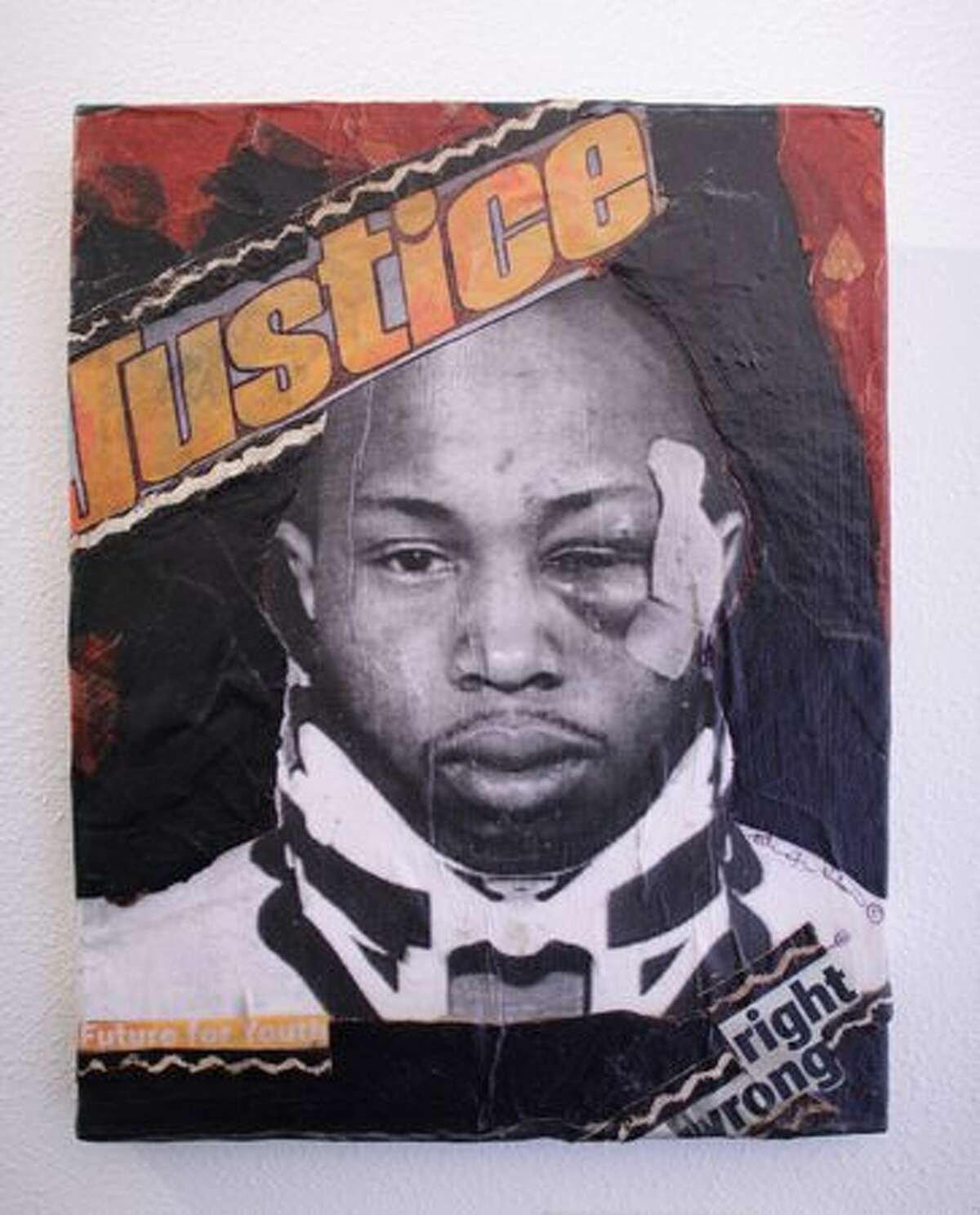 """""""Justice"""" by Patricia Wilson, a collage on canvas, is shown at pun(c)tuation art gallery on East Pike Street in Seattle on Tuesday May 11, 2010. Art at the show deals with the issue of Alley-Barnes and his beating by Seattle Police officers in 2005."""