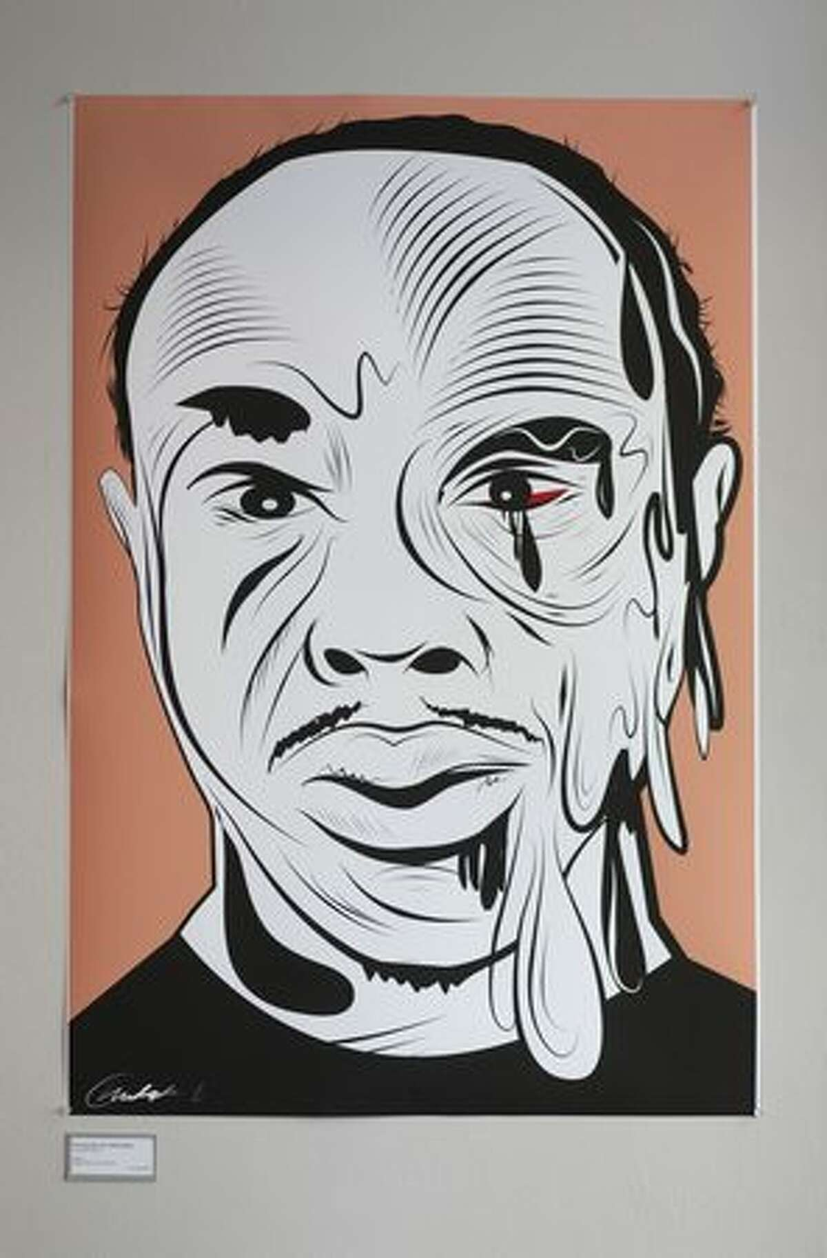 """""""One Eye Can Tell a Whole Story"""" by Christophe Roberts, a digital print, is shown at pun(c)tuation art gallery on East Pike Street in Seattle on Tuesday May 11, 2010. Art at the show deals with the issue of Alley-Barnes and his beating by Seattle Police officers in 2005."""