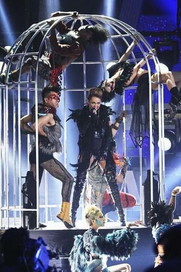"Miley showed a, well, new look in performing her new single, ""Can't Be Tamed"" in 2010. Photo: ABC"