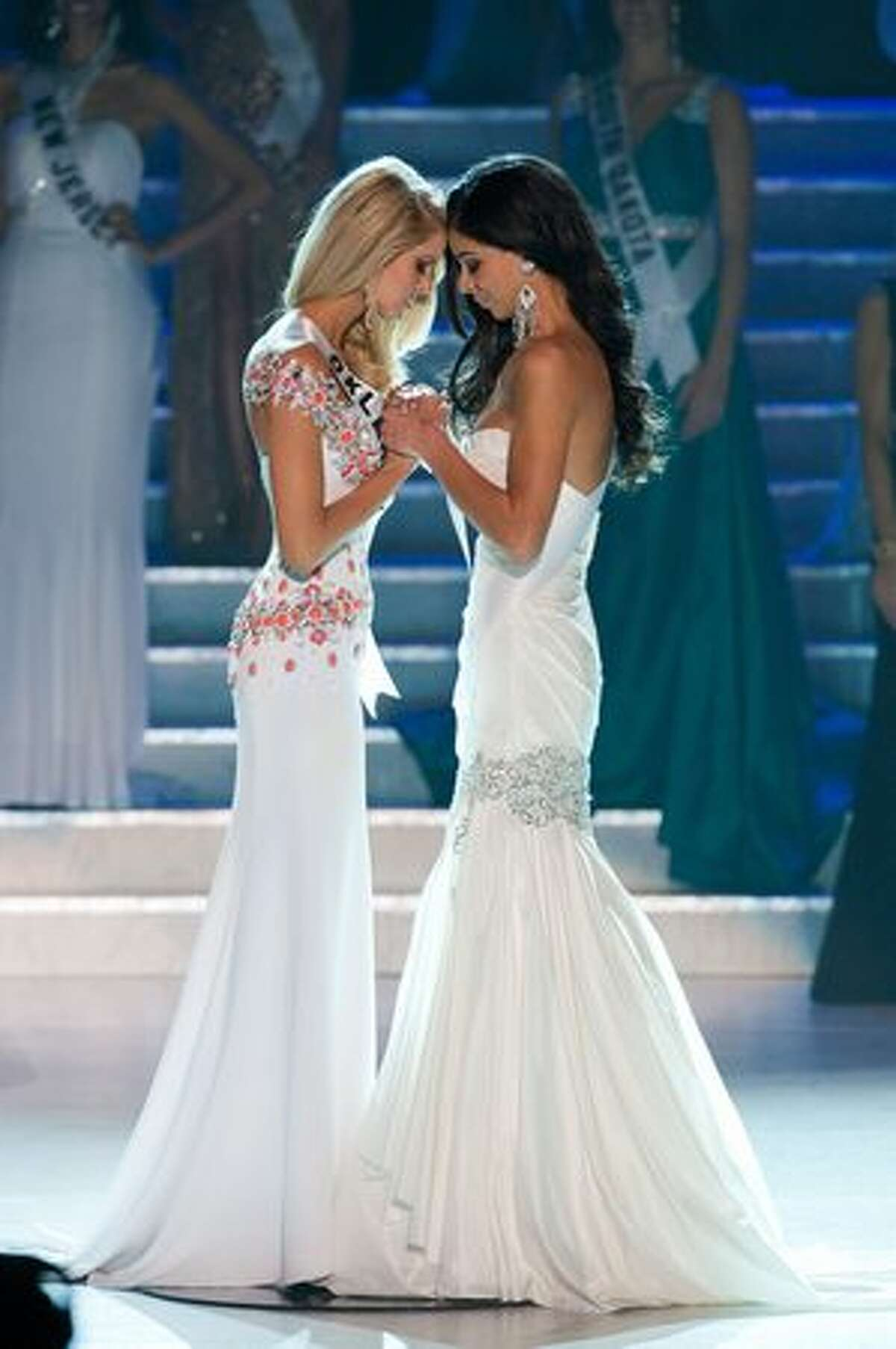 Morgan Elizabeth Woolard, Miss Oklahoma USA 2010, and Rima Fakih, Miss Michigan USA 2010, wait to hear the announcement of Fakih as Miss USA 2010 at the conclusion of the 2010 Miss USA competition at the Planet Hollywood Resort and Casino in Las Vegas on Sunday, May 16, 2010.