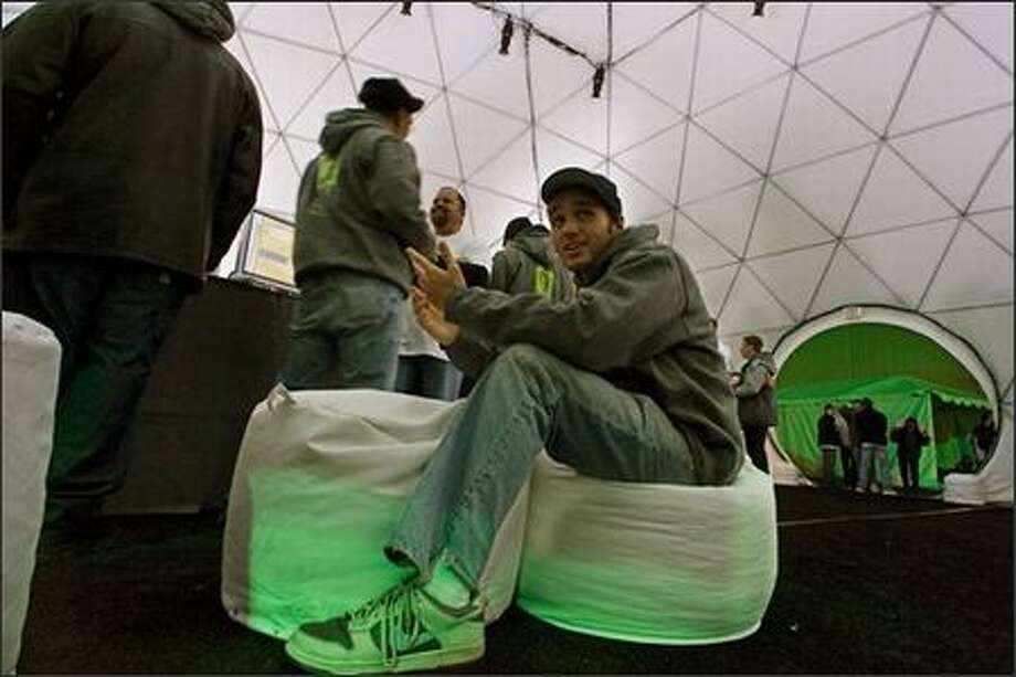 Justin Figueroa, 22, from Queens, N.Y., sits on a beanbag at Microsoft's Xbox 360 launch event in the Mojave Desert. (AP Photo/Damian Dovarganes)