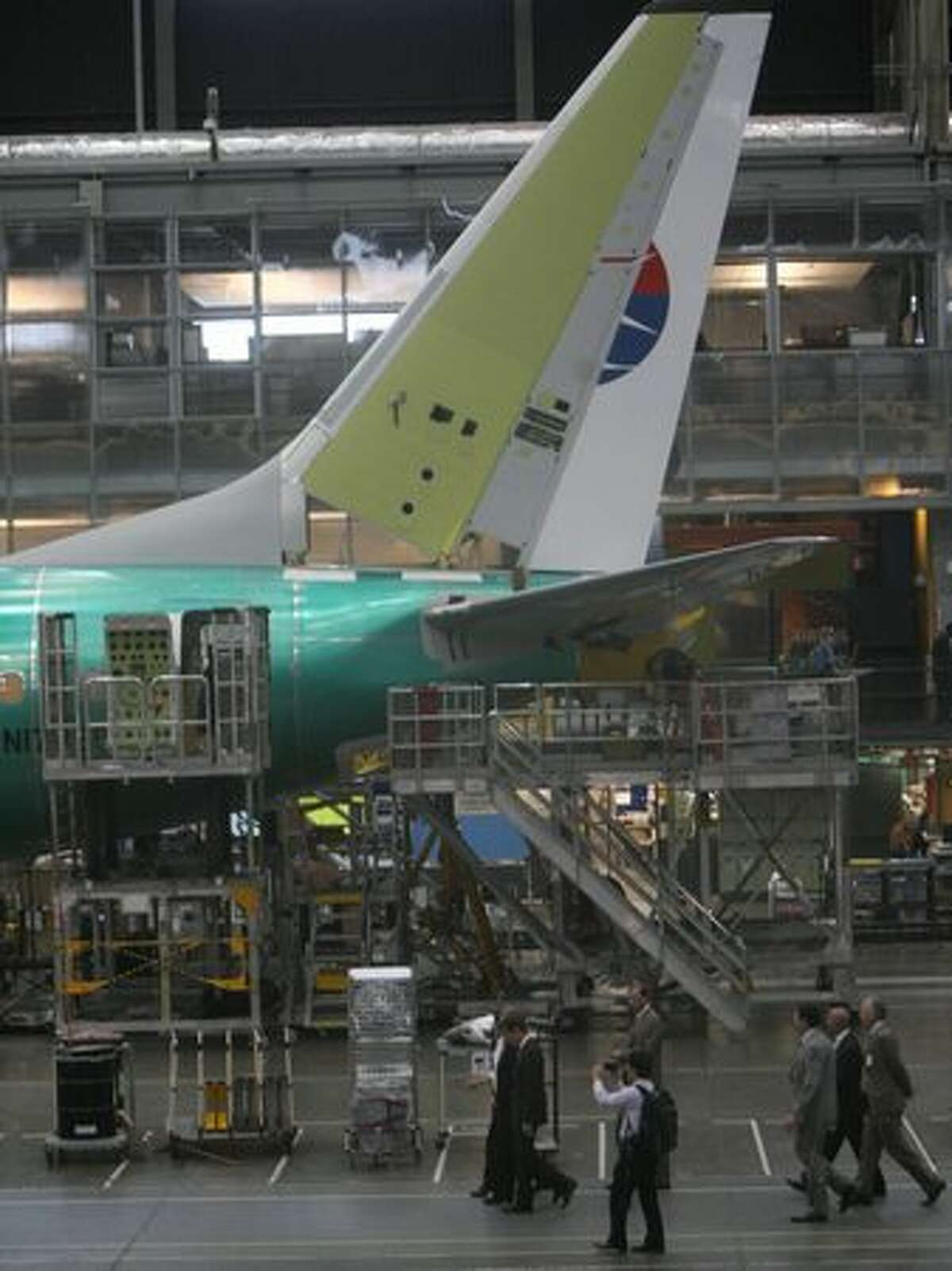 Treasury Secretary Tim Geithner tours Boeing's 737 assembly line, in Renton, Wash., with Boeing executives.
