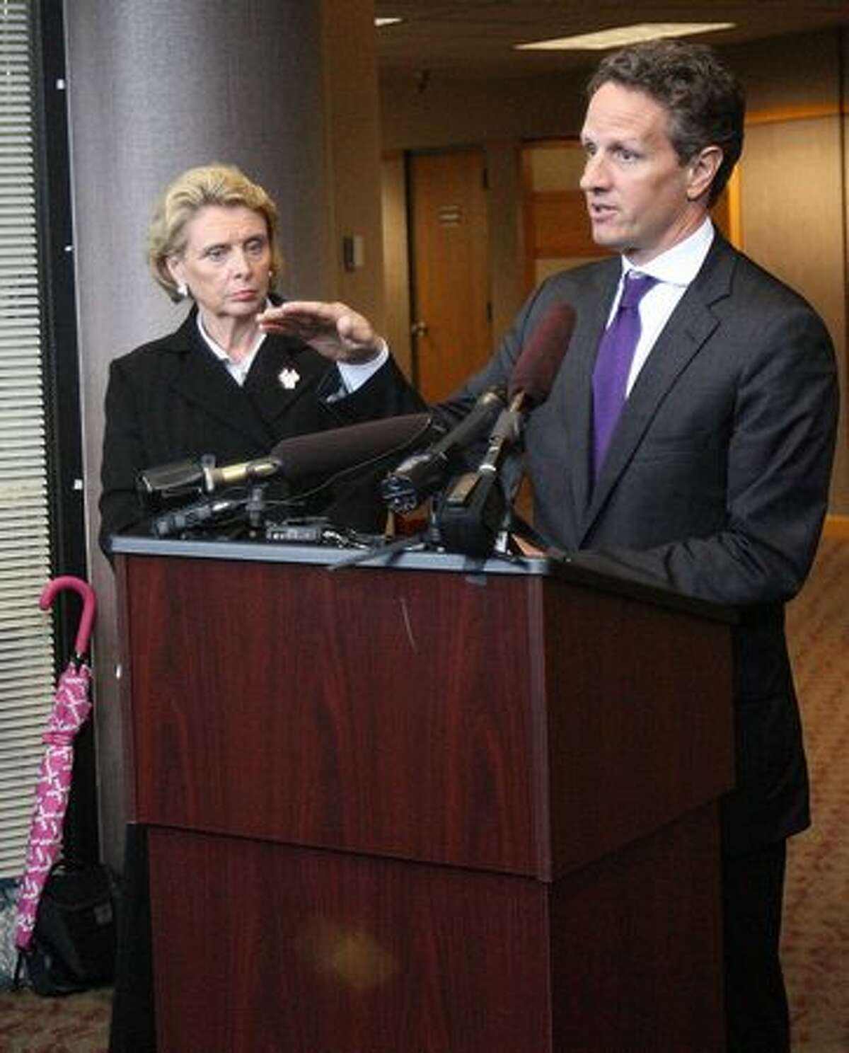Treasury Secretary Tim Geithner talks about trade at the Port of Tacoma while Washington Gov. Chris Gregoire listens.