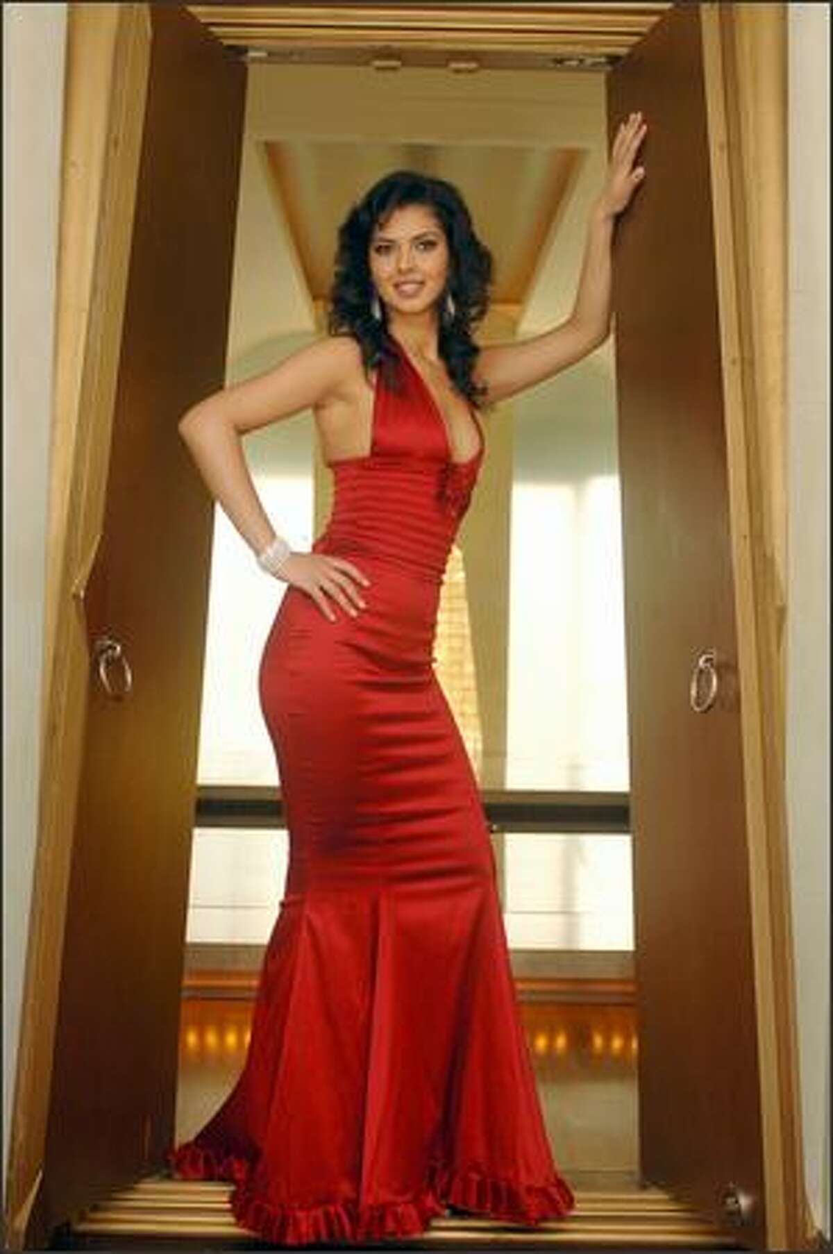 Agnesë Vuthaj, Miss Albania, poses in an evening gown at the Devarana Spa at the Dusit Thani hotel during registration and fittings for the Miss Universe 2005 competition in Bangkok, Thailand on May 11. The 54th annual Miss Universe competition will take place in Bangkok on May 31 (May 30 in U.S. time zones) and will be televised by NBC at 9 p.m. Pacific time on a tape-delayed basis.