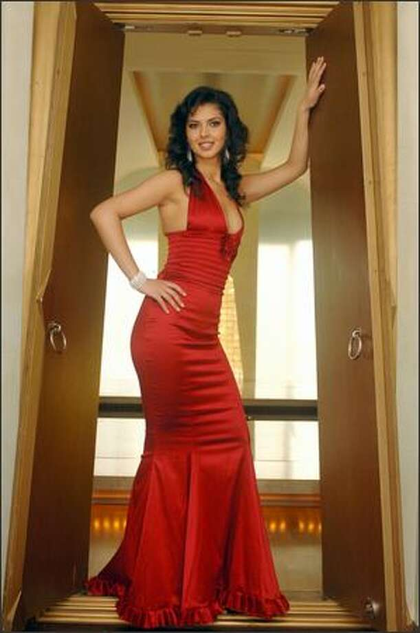 Agnesë Vuthaj, Miss Albania, poses in an evening gown at the Devarana Spa at the Dusit Thani hotel during registration and fittings for the Miss Universe 2005 competition in Bangkok, Thailand on May 11. The 54th annual Miss Universe competition will take place in Bangkok on May 31 (May 30 in U.S. time zones) and will be televised by NBC at 9 p.m. Pacific time on a tape-delayed basis. Photo: Miss Universe L.P., LLLP