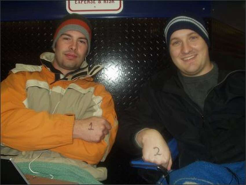 Read 'em and weep. Ryan Ryle, 24, and Josh Watkins, 25, scored spots one and two in line at Northgate's Best Buy.