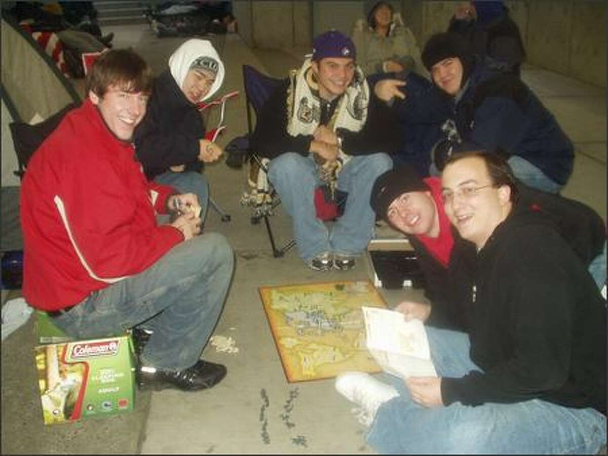 A game of Risk in the Xbox 360 line at the Best Buy at Northgate