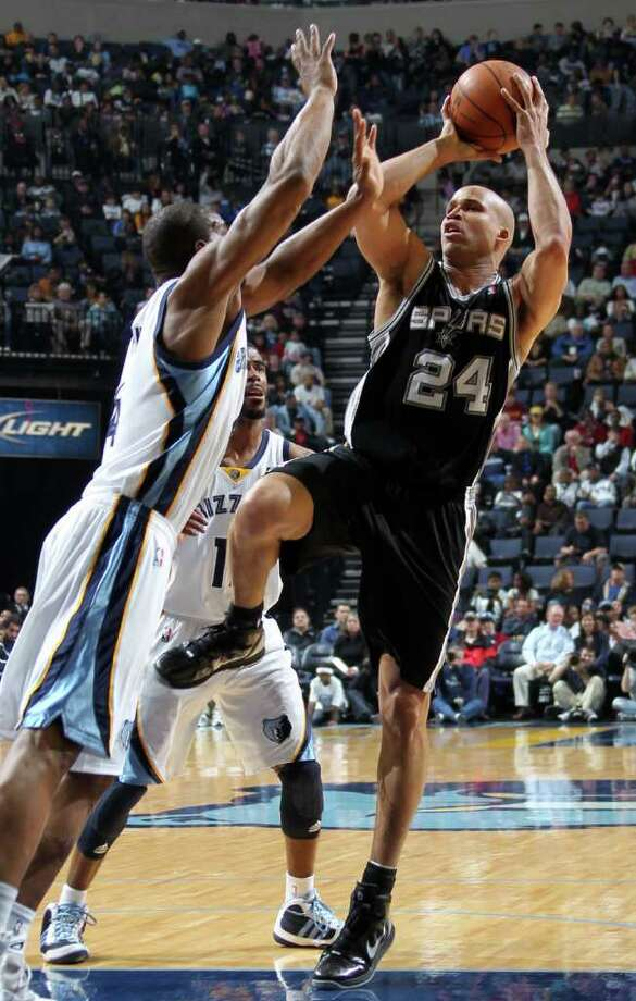San Antonio Spurs forward Richard Jefferson (24) shoots defended by Memphis Grizzlies guard Sam Young, left, and Memphis Grizzlies guard Mike Conley, center, in the first half of an NBA basketball game Sunday, March 27, 2011, in Memphis, Tenn. Photo: AP