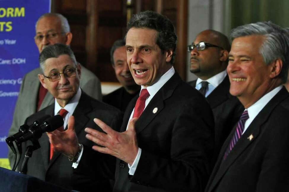 Governor Andrew Cuomo announces a budget agreement with legislative leaders including Assembly Speaker Sheldon Silver, left, and Senate Majority Leader Dean Skelos, right, in the Capitol late Sunday afternoon March 27, 2011 in Albany, NY. ( Philip Kamrass/ Times Union )