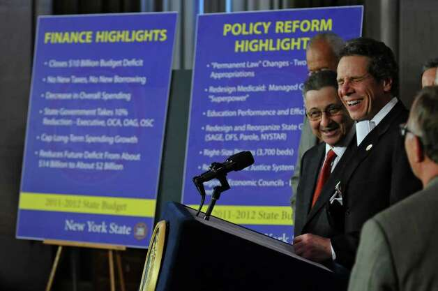 Governor Andrew Cuomo announces a budget agreement with legislative leaders including Assembly Speaker Sheldon Silver, left,  in the Capitol late Sunday afternoon March 27, 2011 in Albany, NY.   ( Philip Kamrass/ Times Union ) Photo: Philip Kamrass