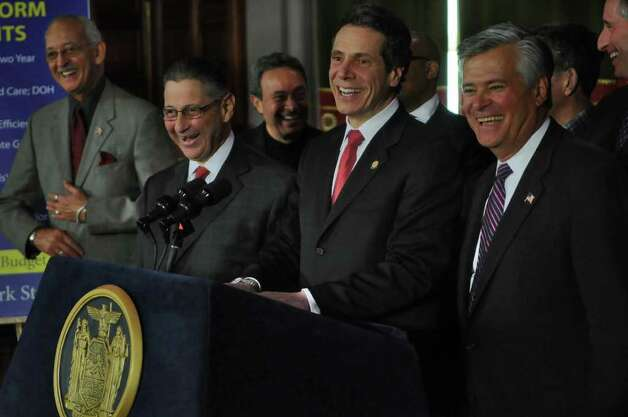 Governor Andrew Cuomo announces a budget agreement with legislative leaders including Assembly Speaker Sheldon Silver, second from left,  and Senate Majority Leader Dean Skelos, right, in the Capitol late Sunday afternoon March 27, 2011 in Albany, NY.  Assemblyman Herman D. Farrell, Jr. is at left. ( Philip Kamrass/ Times Union ) Photo: Philip Kamrass