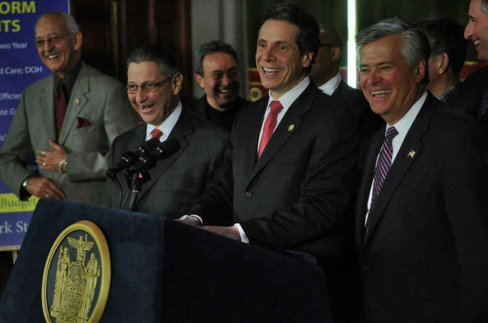 Governor Andrew Cuomo announces a budget agreement with legislative leaders including Assembly Speaker Sheldon Silver, second from left, and Senate Majority Leader Dean Skelos, right, in the Capitol late Sunday afternoon March 27, 2011 in Albany, NY. Assemblyman Herman D. Farrell, Jr. is at left. ( Philip Kamrass/ Times Union )