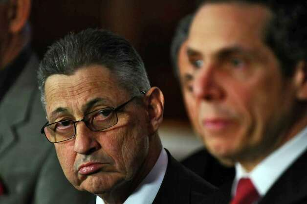 Assembly Speaker Sheldon Silver, left, listens as Governor Andrew Cuomo  announces a budget agreement in the Capitol late Sunday afternoon March 27, 2011 in Albany, NY.  ( Philip Kamrass/ Times Union ) Photo: Philip Kamrass