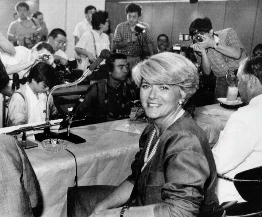 TODAY IN HISTORY/WED 07 12 00/GERALDINE FERRARO -- Geraldine Ferraro, former U.S. vice presidential candidate, poses for photographers prior to the start of her news conference in Tokyo.  The New York Democrat, who in 1984 became the first female candidate for the vice president of the United States, was visiting Japan with her husband and children.  Democratic presidential candidate Walter Mondale announced on July 12, 1984, that he'd chosen Ferraro as his running mate. (PHOTO DATED 7/30/1985)  CREDIT: ASSOCIATED PRESS