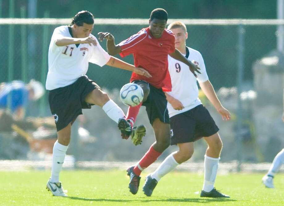 Stamford's Leo Mendle, left, and J.J. Bingham, surround Greenwich's Kenny Doublette during an FCIAC boys soccer match at Stamford High School in Stamford, Conn. on Monday, Sept. 21, 2009 Photo: Chris Preovolos / Stamford Advocate