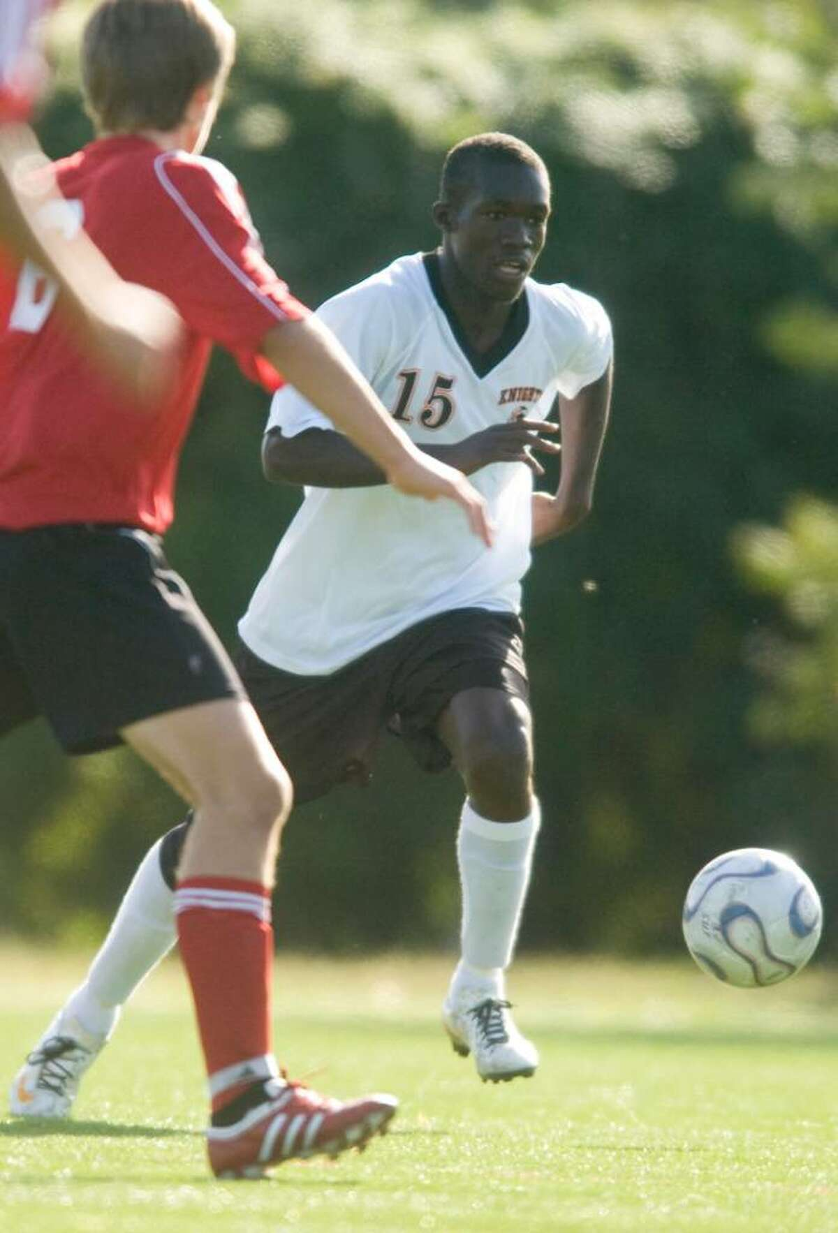 Diego Charles, of Stamford High School, heads downfield during an FCIAC boys soccer match against Greenwich High School at Stamford High School in Stamford, Conn. on Monday, Sept. 21, 2009