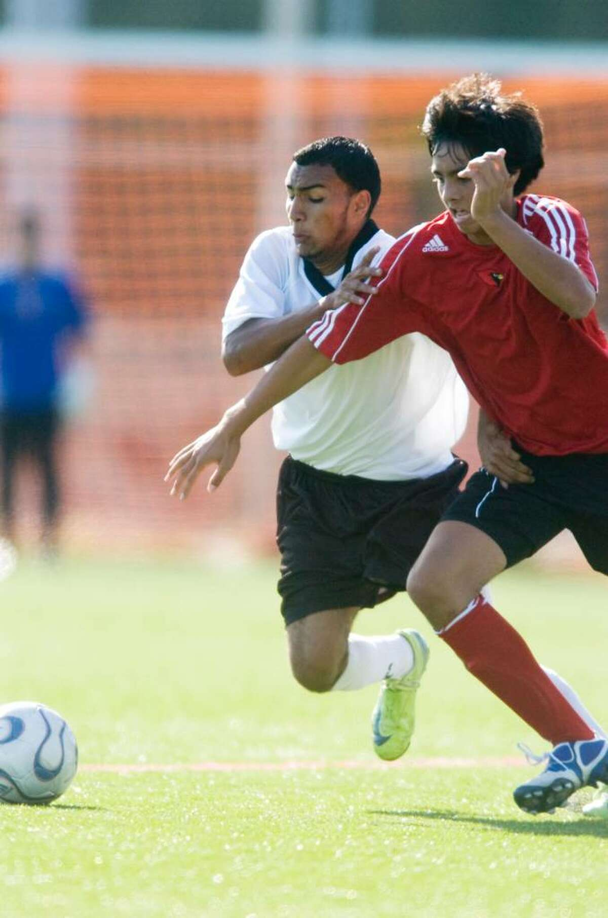 Carlos Calix, left, of Stamford High School and Spencer Tanaka, right, of Greenwich High School go after the ball during an FCIAC boys soccer match at Stamford High School in Stamford, Conn. on Monday, Sept. 21, 2009