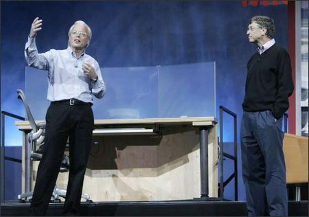 Microsoft chairman and chief software architect Bill Gates, right, listens to Ray Ozzie, chief technical officer, during the company's annual employee meeting. MICROSOFT PHOTO