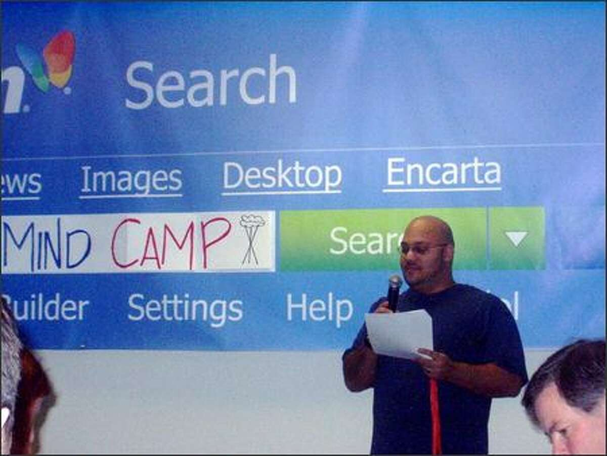 Organizer Andru Edwards opens the Seattle Mind Camp Saturday morning by explaining some of the logistics. All the attendees then passed the microphone around the room to introduce themselves -- but because there were more than 150 people, they were limited to saying their names and three words of their choosing.