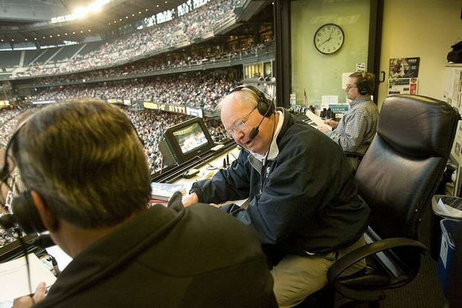 Dave Niehaus talks to Rick Rizzs, left, and the radio fans as he explains how Mariners catcher Jeff Clement had injured his finger. Kevin Cremin is in the background. Photo from July, 2008. (Grant M. Haller/Seattle Post-Intelligener)