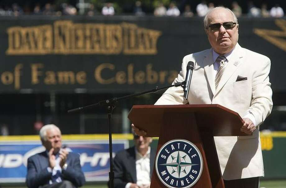 Seattle Mariners broadcaster Dave Niehaus speaks while being honored before a game against the Baltimore Orioles, Sunday August 3, 2008, at Safeco Field in Seattle. Niehaus, the Mariners' broadcaster since the team's inaugural season, was recently inducted into the Baseball Hall of Fame. (AP Photo/Stephen Brashear)