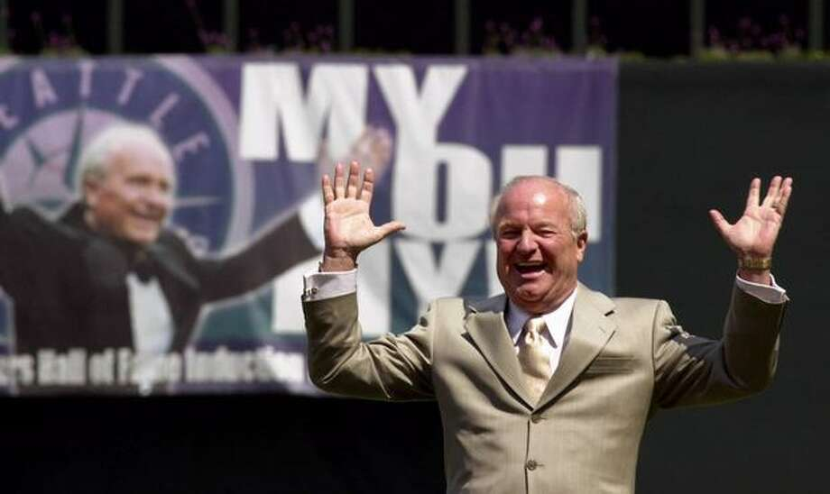 Seattle Mariners broadcaster Dave Niehaus reacts to the applause of the pre-game crowd as he is inducted into the team's Hall of Fame on Sunday, May 7, 2000, in Seattle. Niehaus has been broadcasting for the Mariners since their inaugural season in 1977. (AP Photo/Elaine Thompson)