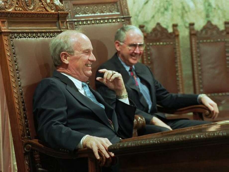 Seattle Mariners announcer Dave Niehaus, left, laughs with House Speaker Clyde Ballard, R-East Wenatchee, as Neihaus is honored Tuesday, April 8, 1997, with a resolution in the House in Olympia, Wash. The resolution praised Neihaus for his 20 years as announcer for the team and his contribution to the quality of life in the Pacific Northwest.(AP Photo/Louie Balukoff)