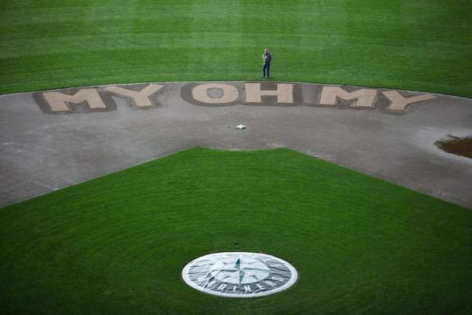 The infield of Safeco Field features Dave Niehaus' signature saying on Thursday. Photo: Joshua Trujillo, Seattlepi.com / seattlepi.com