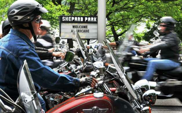 Motorcyclists pass a welcome sign June 5, 2009, at Shepard Park on Canada Street  during Americade in Lake George. (John Carl D'Annibale / Times Union archive) Photo: John Carl D'Annibale / 00004215A