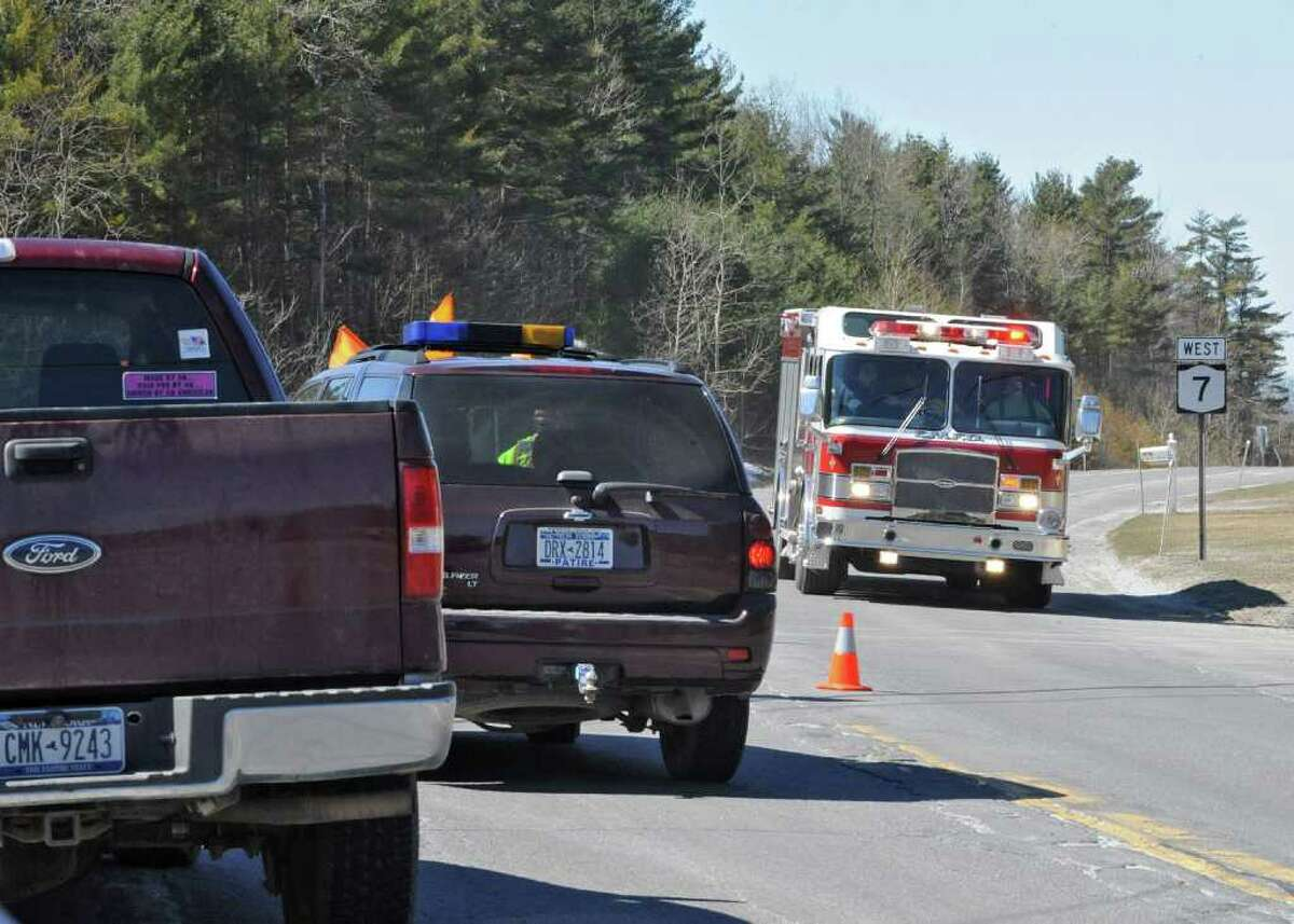 Emergency vehicles head up Route 7 past a police checkpoint that was diverting traffic right onto Babcock Lake Road in Hoosick Falls, NY, on March 28, 2011. A tractor-trailer hauling 10,000 gallons of propane rolled over and caught fire Monday afternoon. (Lori Van Buren / Times Union)
