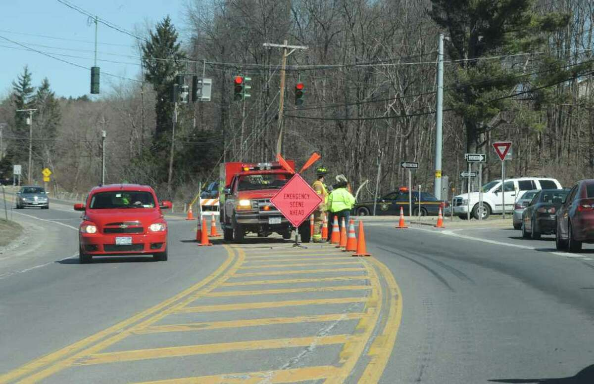 An emergency checkpoint on Route 7 diverting traffic right onto Babcock Lake Road in Hoosick Falls, NY, on March 28, 2011. A tractor-trailer hauling 10,000 gallons of propane rolled over and caught fire Monday afternoon. (Lori Van Buren / Times Union)
