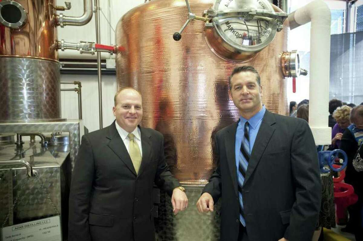 Cinco Vodka co-founders Trey Azar (left) and Steve Dean will have their new vodka on the shelves on April 7, the first day of Fiesta.