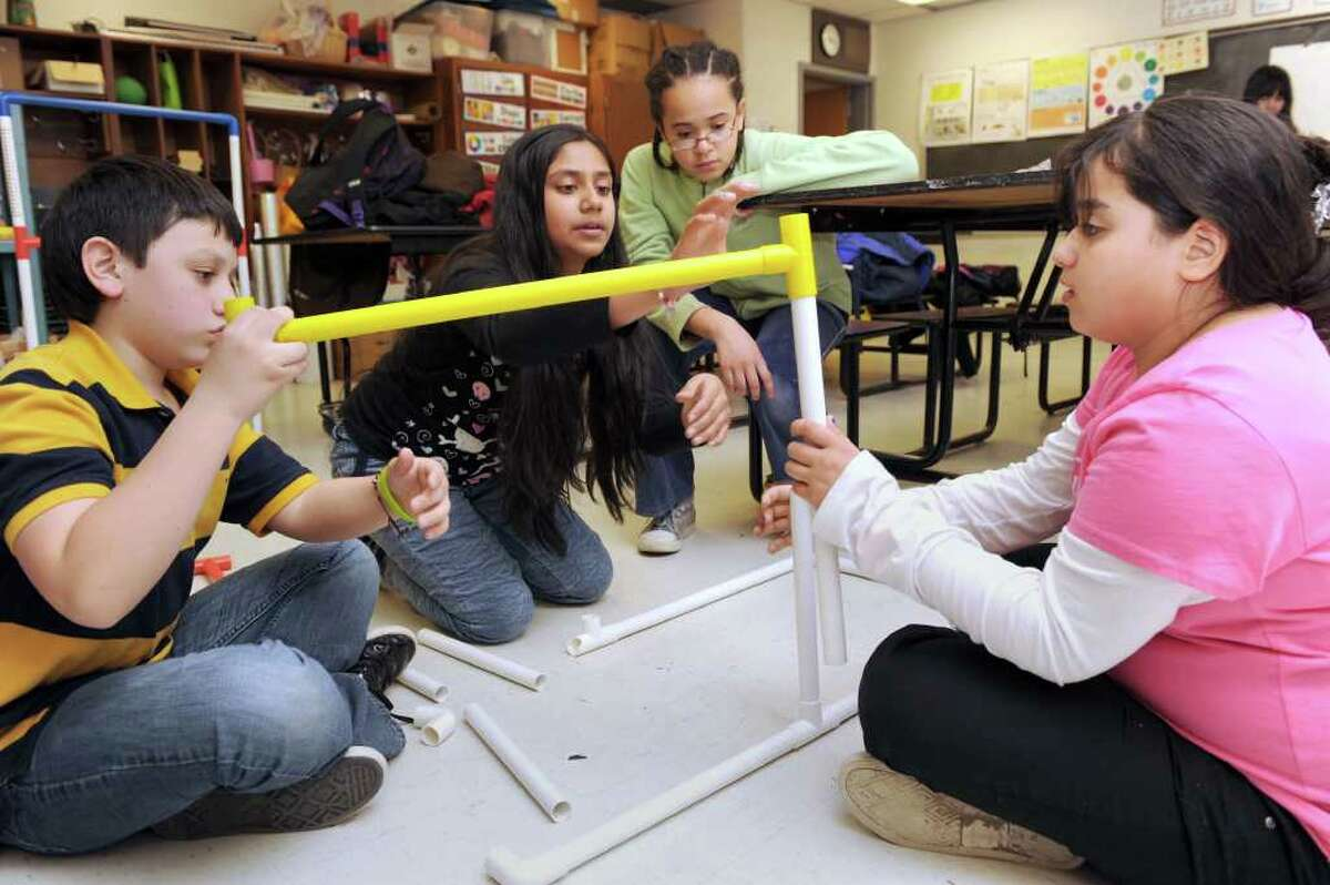 From left to right, Daniel Aristizabal, 11, Shivani Patel, 11, Jayme Cole, 10, and Annalise Droz, 10, assemble a ladder ball game during a meeting of the 5th Grade Upper EL club at Morris Street School in Danbury on Monday, March 28, 2011.