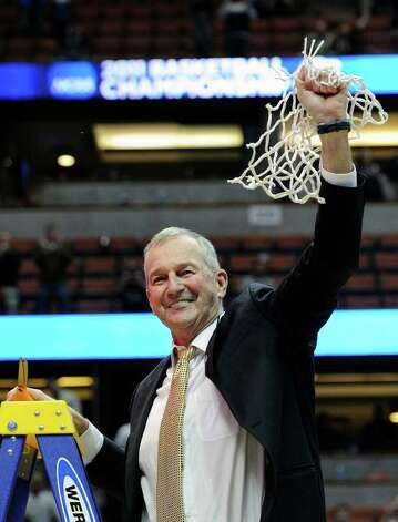 Connecticut head coach Jim Calhoun, holds the net after his team beat Arizona 65-63 after the NCAA West regional college basketball championship game, Saturday, March 26, 2011, in Anaheim, Calif.  (AP Photo/Mark J. Terrill) Photo: AP