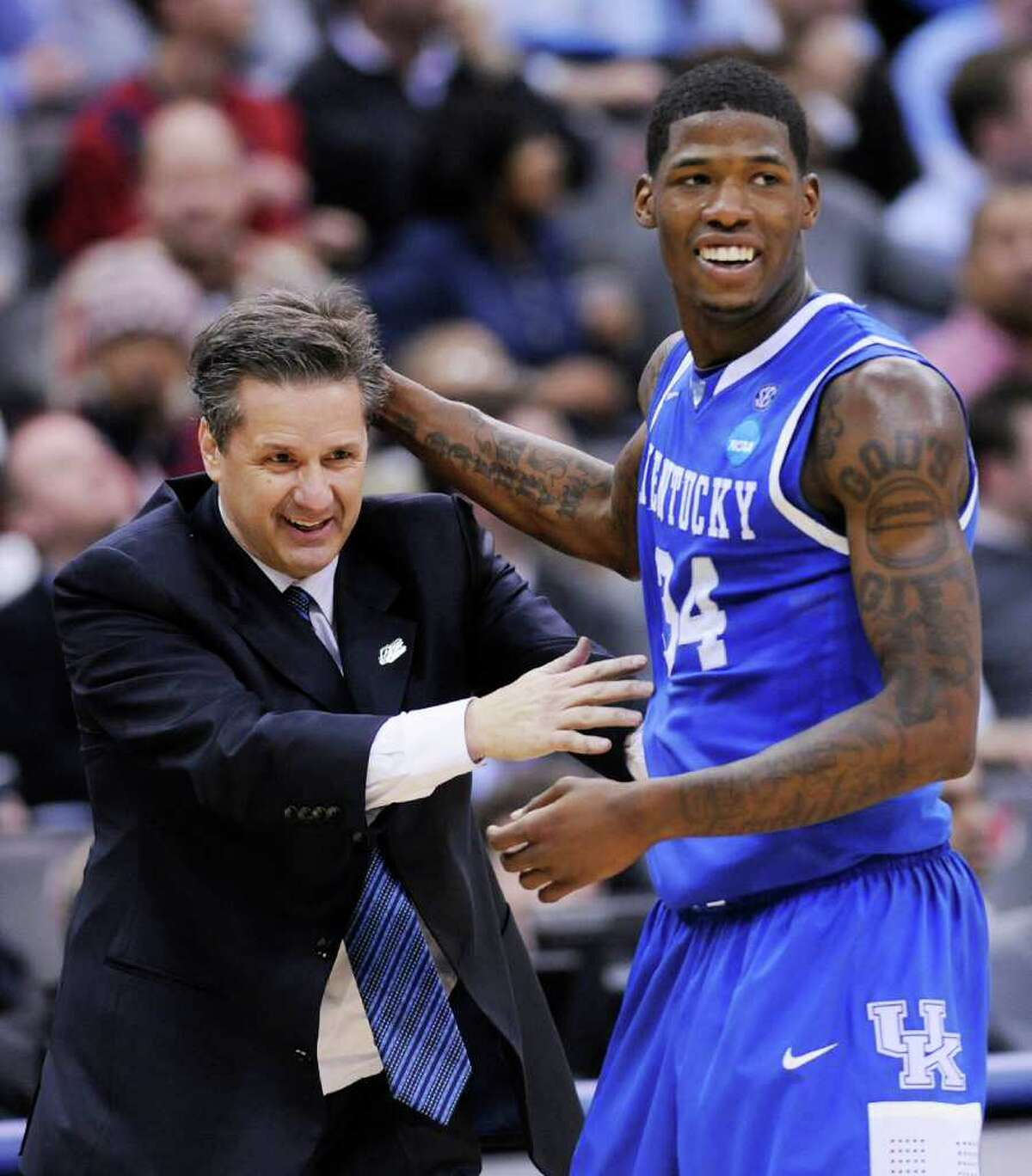 Kentucky coach John Calipari celebrates with DeAndre Liggins (34) during the second half of the final of the NCAA men's college basketball tournament East regional against North Carolina, Sunday, March 27, 2011, in Newark, N.J. Kentucky won 76-69. (AP Photo/Bill Kostroun)