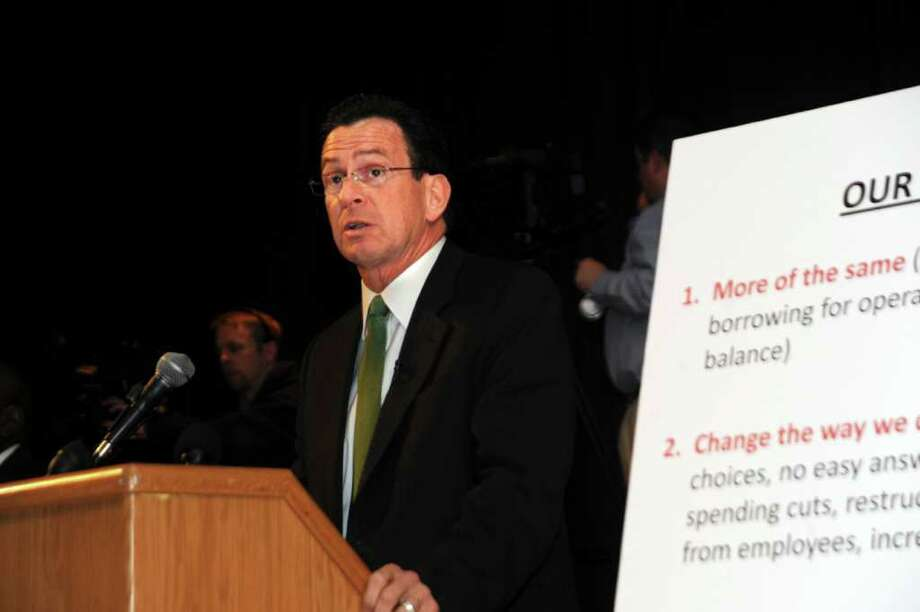 Gov. Dannel P. Malloy at the town hall-style meeting in which he discussed the state's pressing economic and budgetary issues face-to-face with state residents, and listen to their own thoughts and suggestions, at the Eastern Middle School, in Riverside, on Monday, March 28, 2011. Photo: Helen Neafsey / Greenwich Time