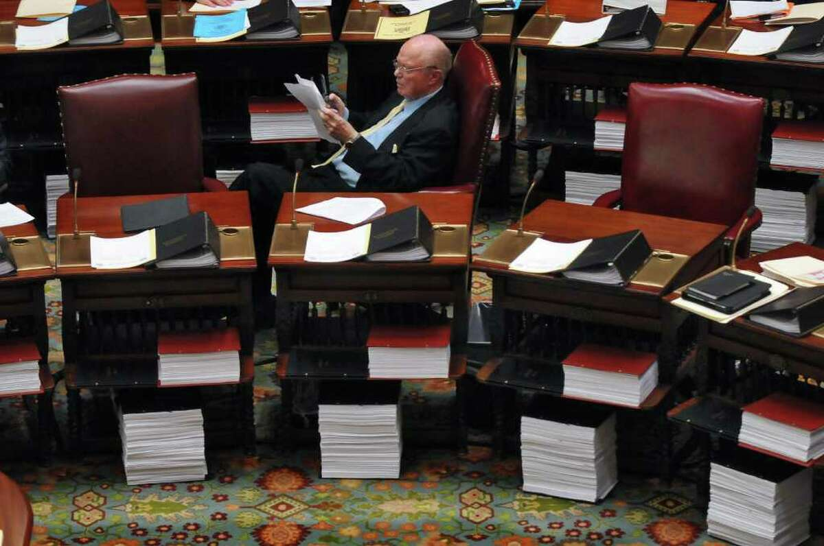 State Senator Hugh Farley reads through paperwork at his desk in the Senate chamber on Monday evening March 28, 2011 in Albany, NY. ( Philip Kamrass/ Times Union )