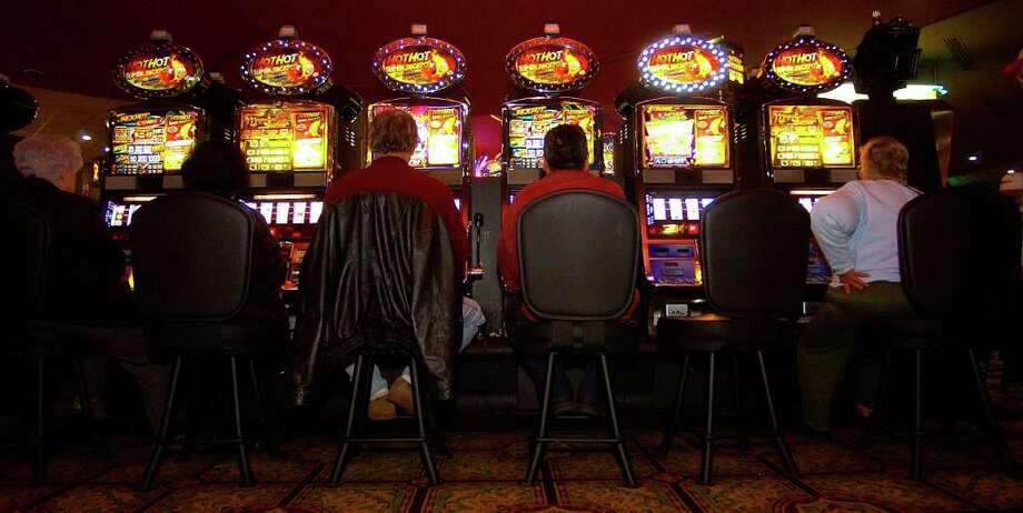 People fill the chairs in front of a row of slot machines at the Coushatta Casino Resort in January, 2009. The Texas Legislature is looking at a bill to allow gambling casinos in the state. Rep. Mike Hamilton is co-author of the bill. Enterprise file photo / Beaumont