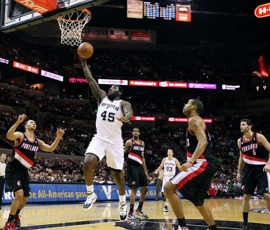 FOR SPORTS - Spurs' DeJuan Blair shoots between Trail Blazers defenders during first half action Monday March 28, 2011 at the AT&T Center.  (PHOTO BY EDWARD A. ORNELAS/eaornelas@express-news.net) / SAN ANTONIO EXPRESS-NEWS (NFS)