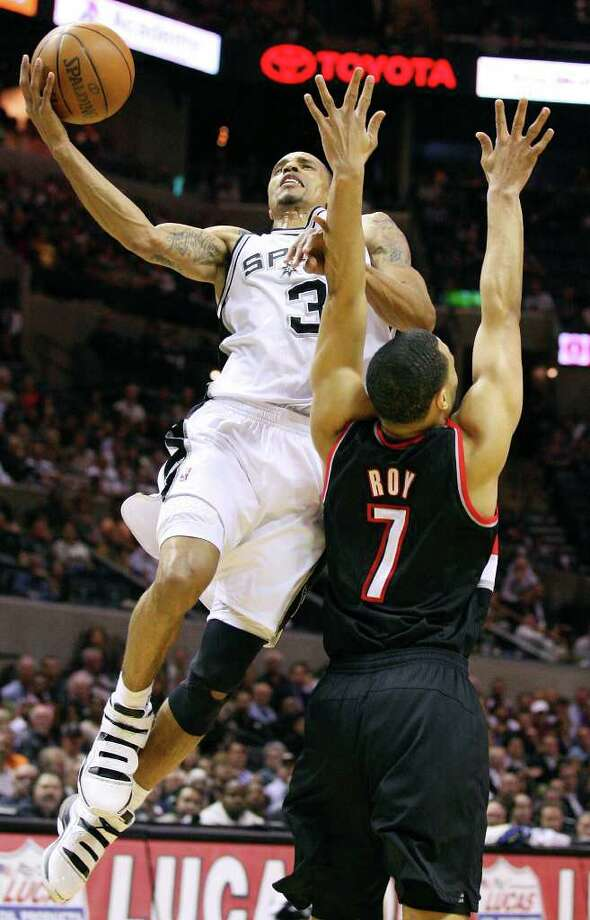 Spurs' George Hill shoots around Trail Blazers' Brandon Roy during first half action Monday March 28, 2011 at the AT&T Center.  (PHOTO BY EDWARD A. ORNELAS/eaornelas@express-news.net) / SAN ANTONIO EXPRESS-NEWS (NFS)
