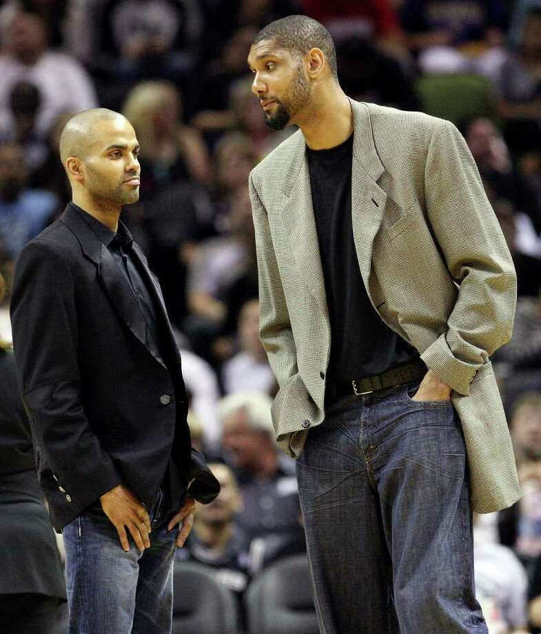 FOR SPORTS - Spurs' Tony Parker and Spurs' Tim Duncan stand on the court during a timeout against the Trail Blazers in the second half Monday March 28, 2011 at the AT&T Center.  The Trail Blazers won 100-92. (PHOTO BY EDWARD A. ORNELAS/eaornelas@express-news.net) / SAN ANTONIO EXPRESS-NEWS (NFS)