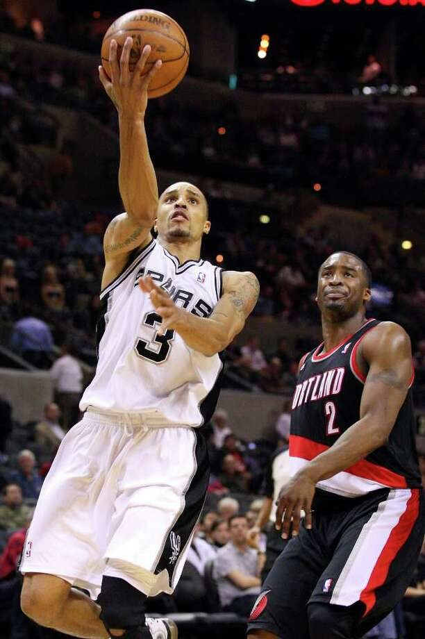 FOR SPORTS - Spurs' George Hill shoots around Trail Blazers' Wesley Matthews during second half action Monday March 28, 2011 at the AT&T Center.  The Trail Blazers won 100-92. (PHOTO BY EDWARD A. ORNELAS/eaornelas@express-news.net) / SAN ANTONIO EXPRESS-NEWS (NFS)