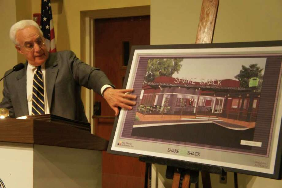Westport attorney Larry Weisman presents an artist's rendering of the planned Shake Shack restaurant at 1849 Post Road East to the Planning and Zoning Commission on Thursday, March 10, 2011. Photo: Paul Schott / Westport News
