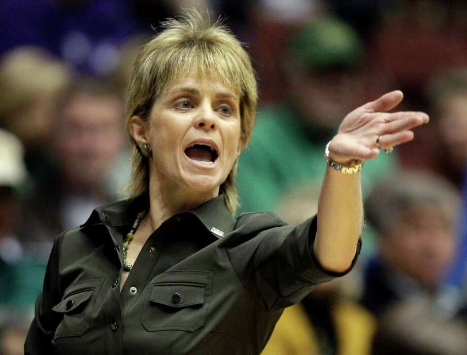 Baylor head coach Kim Mulkey yells out from the sideline during the second half of an NCAA college basketball game against Kansas at the Big 12 Conference women's tournament on Wednesday, March 9, 2011, in Kansas City, Mo. Baylor won 86-51. Photo: AP