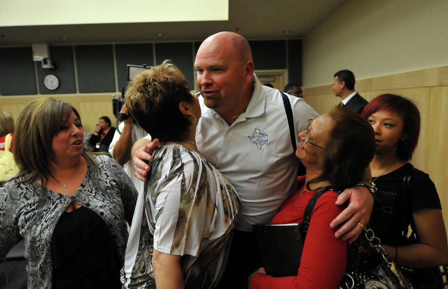 South San Independent School District Athletic Director Gary Durbon receives congratulations after the school board meeting was canceled. Photo: Robin Jerstad/Special To The Express-News / Copyright 2011 by Robin Jerstad-Jerstad Photographics LLC-210254-6552