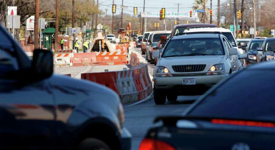 Part of Broadway is closed earlier this month near Hildebrand Avenue, part of a project to control flooding at the intersection. The project's main phase, which includes the flood control and new traffic lanes, is expected to take 18 months. Photo: William Luther/Express-News / SAN ANTONIO EXPRESS-NEWS