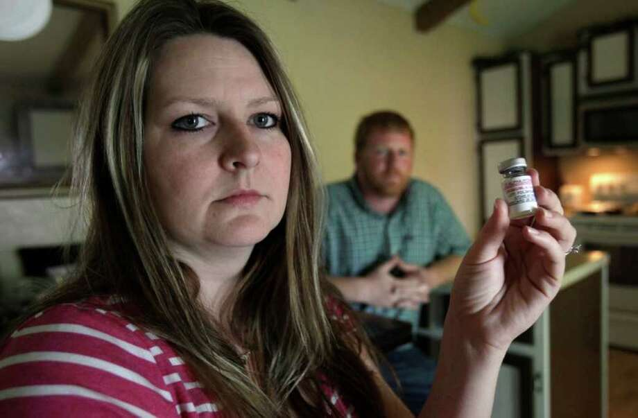 The drug that Amanda Miller, shown with her husband, James, takes to prevent premature birth rose from $11 per shot to $1,500. Photo: Bob Owen/Express-News / rowen@express-news.net
