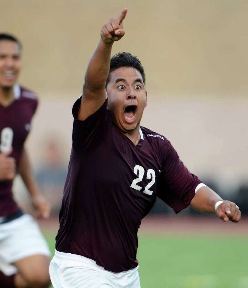Highlands' Gilberto Ojeda (22) celebrates after scoring the go ahead goal  late in the match during a first round 5A boys playoff soccer match between the Highlands Owls and the Brandeis Broncos at Farris Stadium in San Antonio, Texas on March 28, 2011  John Albright / Special to the Express-News. Photo: JOHN ALBRIGHT, San Antonio Express-News / San Antonio Express-News
