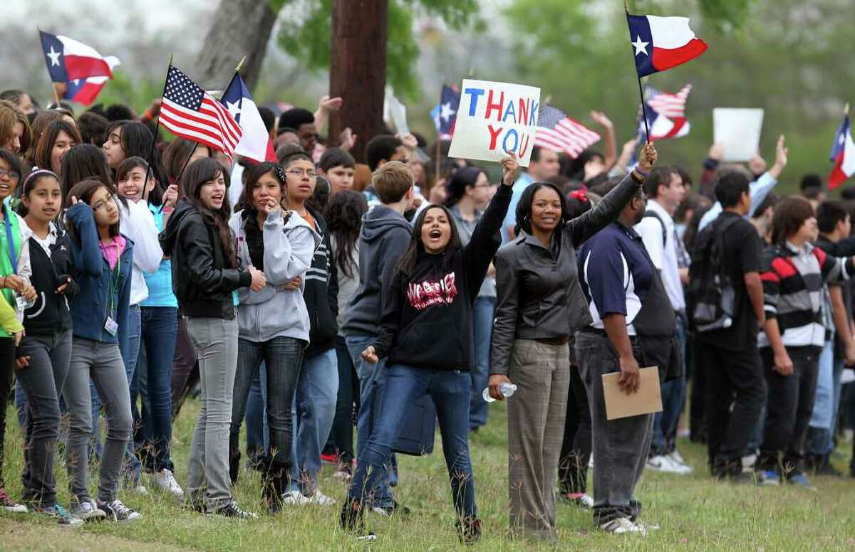 Students from Henry Metzger Middle School line up on Binz-Engleman Road to cheer on passing cyclists on Monday, March 28, 2011, as participants in the Ride 2 Recovery Texas Challenge pass by. The ride finishes Saturday in Arlington and supports rehabilitation for injured veterans.